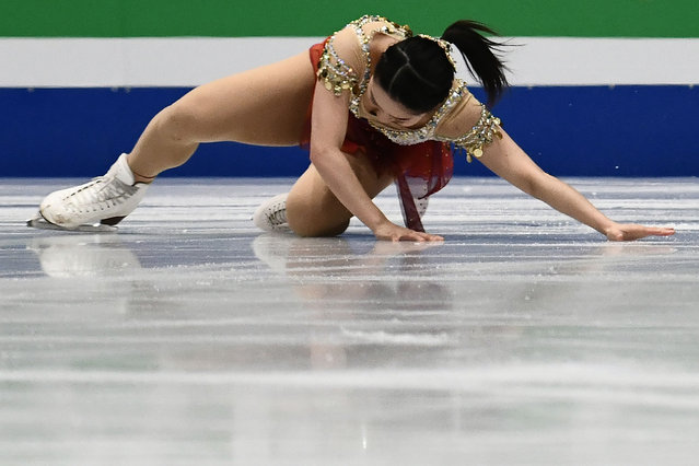 Japan' s Wakaba Higuchi falls on March 21, 2018 in Milan during the Ladies figure skating short program at the Milano World Figure Skating Championship 2018. (Photo by Marco Bertorello/AFP Photo)