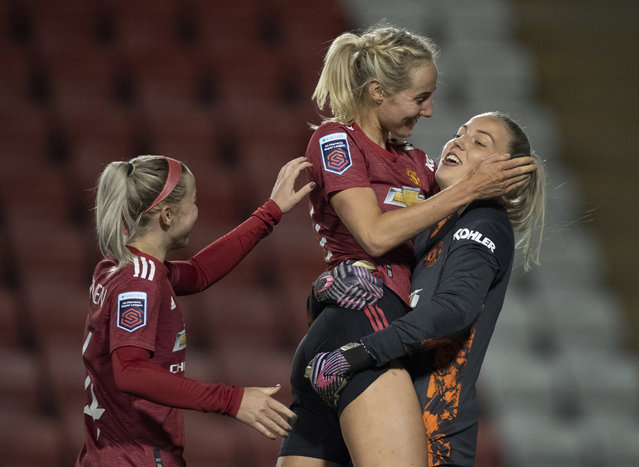 Manchester United goalkeeper Emily Ramsey celebrates with team mates Millie Turner and Jackie Groenen after winning the penalty shoot out at the FA Women's Continental League Cup match between Manchester United and Manchester City at Leigh Sports Village on November 19, 2020 in Leigh, England. Sporting stadiums around the UK remain under strict restrictions due to the Coronavirus Pandemic as Government social distancing laws prohibit fans inside venues resulting in games being played behind closed doors. (Photo by Visionhaus)