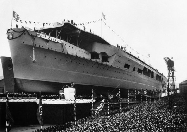 The Graf Zeppelin, Germany's first aircraft carrier, gliding down the slipway at Kiel, on December 8, 1938. (Photo by AP Photo)
