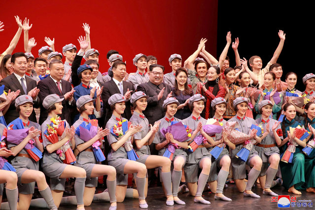 North Korean leader Kim Jong Un, his wife Ri Sol Ju and Song Tao, head of the International Department of Communist Party of China (CPC) Central Committee, applaud with ballet dancers in this undated photo released by North Korea's Korean Central News Agency (KCNA) in Pyongyang April 17, 2018. (Photo by Reuters/KCNA)