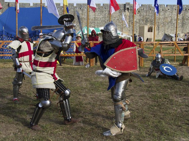 "Members of the  UK team, left, fight against a Czech Republic contestant during the ""Battle of Nations"" in Aigues-Mortes, southern France, Friday, May 10, 2013 where Middle Ages fans attend the historical medieval battle competition. The championship will be attended by 22 national teams, which is twice the number it was last year. The battle lasts until May 12.(Photo by Philippe Farjon/AP Photo)"