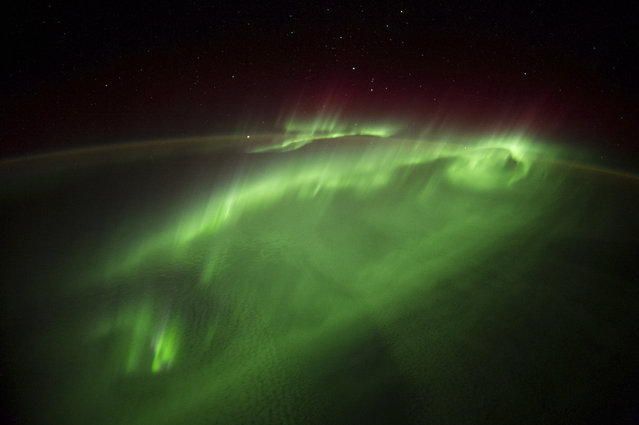 Aurora borealis or northern lights display, seen from the International Space Station (ISS) on September 29, 2014. (Photo by NASA/SPL/Barcroft Media)