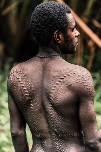 One of the tribes pictured are the Kangunaman, who scar their backs to resemble reptile scales. (Photo by Trevor Cole/Media Drum World)