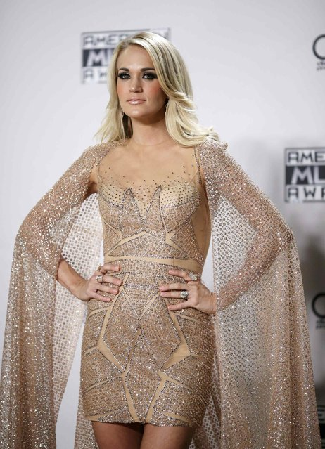 Singer Carrie Underwood poses backstage during the 2015 American Music Awards in Los Angeles, California November 22, 2015. (Photo by David McNew/Reuters)