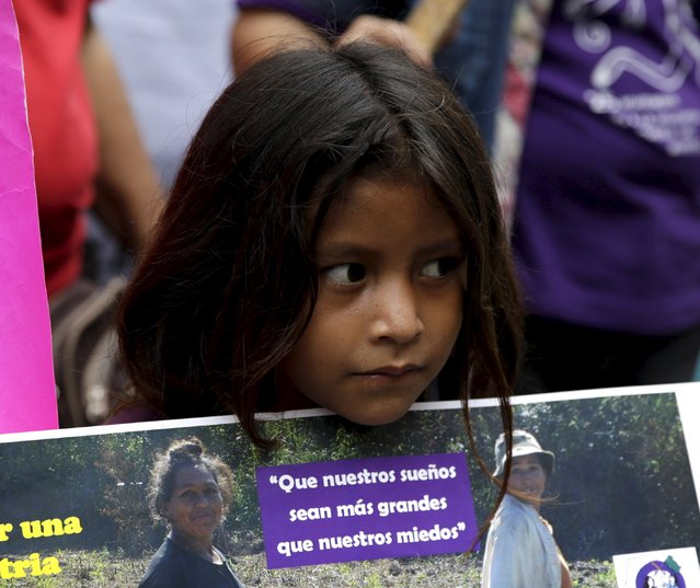 """A girl is pictured with a sign that says """"That our dreams are bigger than our fears"""" during a march to commemorate International Day for the Elimination of Violence Against Women in Asuncion, November 25, 2015. (Photo by Jorge Adorno/Reuters)"""
