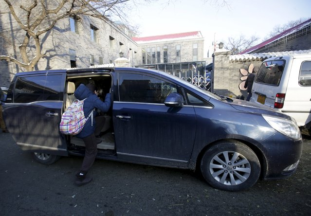 A primary school student gets into a minivan as her mother picks her up outside her school, in Beijing, November 25, 2015. Automakers are betting that Chinese families will embrace the mini-van, hoping the larger, unsexy sibling of the bestselling SUV will become the next big thing just as Beijing relaxes the one-child policy. (Photo by Jason Lee/Reuters)