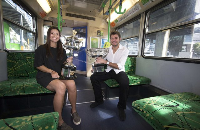 Current Australian Open tennis champions China's Li Na and Switzerland's Stan Wawrinka hold the Men's and Women's singles trophies as they sit on a tram before the start of the official draw ceremony outside Rod Laver Arena at Melbourne Park, in this January 16, 2015 handout picture. The Australian Open tennis tournament begins on January 19. (Photo by Fiona Hamilton/Reuters/Tennis Australia)