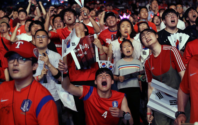 In this Monday, June 18, 2018, file photo, South Korean soccer fans react as they watch a live broadcasting of the Group F World Cup soccer match between South Korea and Sweden at a public viewing venue in Seoul, South Korea. (Photo by Ahn Young-joon/AP Photo)