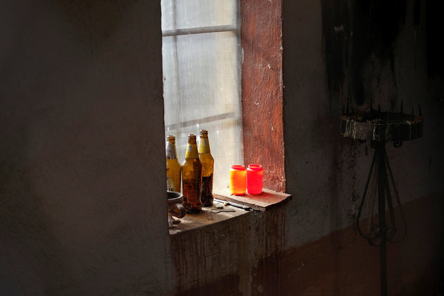 Empty bottles of beer are seen inside a chapel at a cemetery in the village of Sapine, Serbia, October 25, 2016. (Photo by Marko Djurica/Reuters)