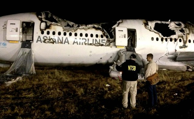 NTSB investigators conduct a first site assessment overnight of Asiana Airlines flight 214 that crashed at the San Francisco International Airport. The Asiana Airlines Boeing 777 crashed while landing after a 10-hour-plus flight from Seoul, South Korea. The flight originated in Shanghai and had stopped in Seoul before the flight to San Francisco. (Photo by NTSB)