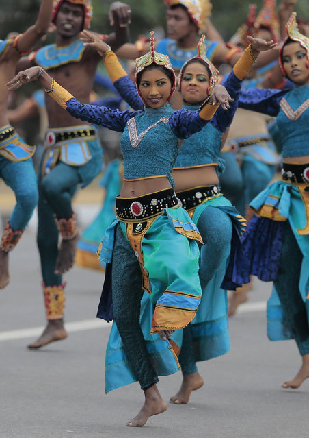 Sri Lankan dancers perform during Independence Day celebrations in Colombo, Sri Lanka, Wednesday, February 4, 2015. (Photo by Eranga Jayawardena/AP Photo)