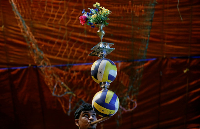 A member of Sakura circus team performs during the second day of a one week show in Padukka, near Colombo, Sri Lanka November 28, 2016. (Photo by Dinuka Liyanawatte/Reuters)