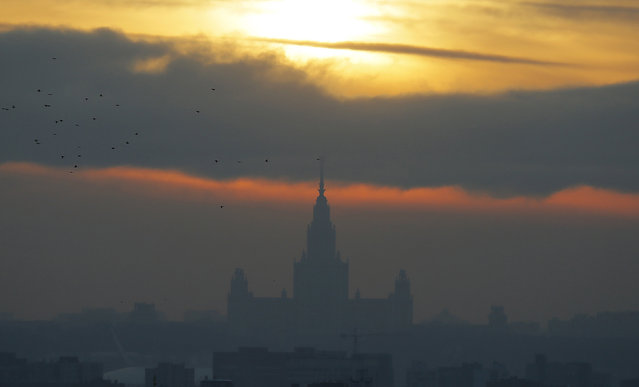 The sun sets over the Moscow State University on a frosty winter day in Moscow, Russia, January 11, 2016. (Photo by Maxim Shemetov/Reuters)