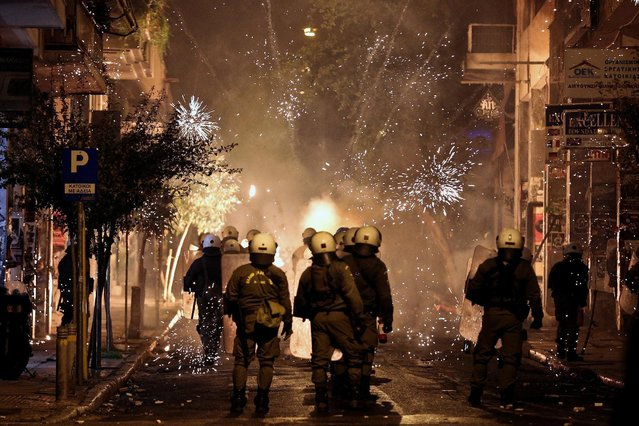 Fireworks explode next to riot police during clashes following an anniversary rally marking the 2008 police shooting of 15-year-old student, Alexandros Grigoropoulos, in Athens, Greece, December 6, 2016. (Photo by Alkis Konstantinidis/Reuters)