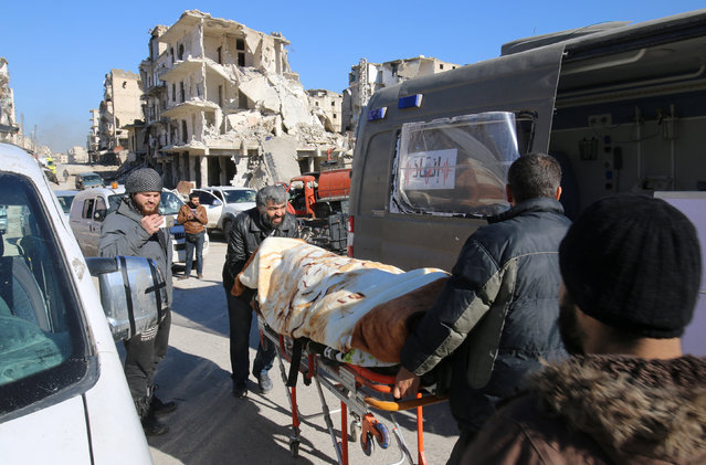 Men push an evacuee on a stretcher as vehicles wait to evacuate people from a rebel-held sector of eastern Aleppo, Syria December 15, 2016. (Photo by Abdalrhman Ismail/Reuters)