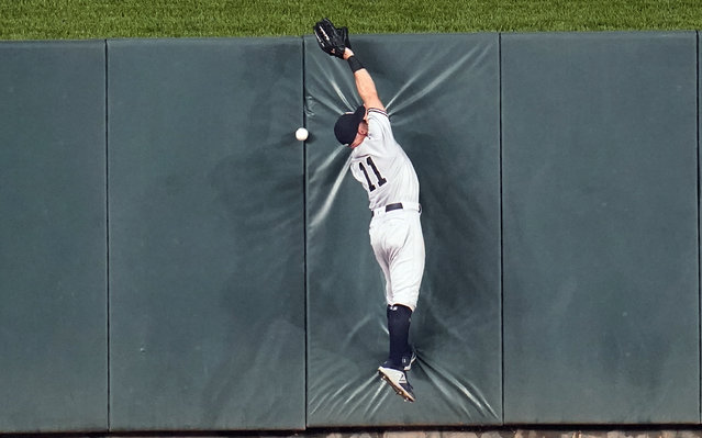 New York Yankees center fielder Brett Gardner can't make the catch as Minnesota Twins' Alex Kirilloff triples off the wall in center field in the ninth inning of a baseball game, Wednesday, June 9, 2021, in Minneapolis. The Yankees won 9-6. (Photo by Jim Mone/AP Photo)