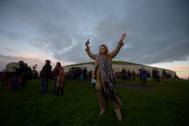 Revellers celebrate during winter solstice at the 5000 year old stone age tomb of Newgrange in the Boyne Valley at sunrise in Newgrange, Ireland, December 21, 2016. (Photo by Clodagh Kilcoyne/Reuters)