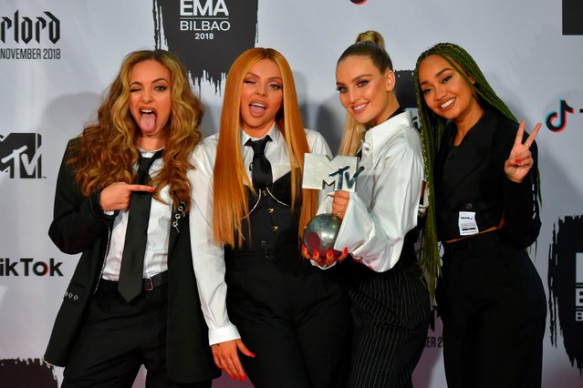 British group Little Mix pose backstage with the Best UK act award during the MTV Europe Music Awards at the Bizkaia Arena in the northern Spanish city of Bilbao on November 4, 2018. (Photo by Ander Gillenea/AFP Photo)