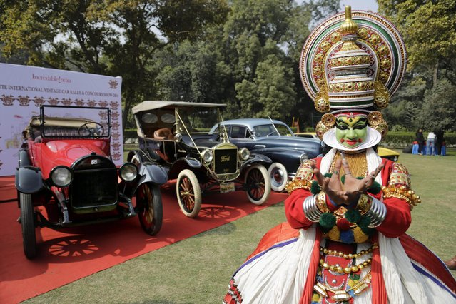 An Indian classical dancer poses next to newly restored vintage cars ahead of their car rally organized by the 21 Gun Salute in New Delhi, India, Thursday, January 28, 2016. The 21 Gun Salute organizes an annual vintage car rally which will be held on Feb. 6 and 7, where more than 100 hand-picked vintage and classic cars will participate. (Photo by Altaf Qadri/AP Photo)