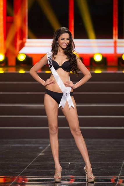 This photo provided by the Miss Universe Organization shows Manasi Moghe, Miss India 2013, competes in the swimsuit competition during the Preliminary Competition at Crocus City Hall, Moscow, on November 5, 2013. (Photo by Darren Decker/AFP Photo)