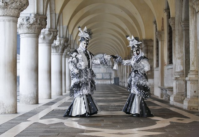 Masked revellers pose during the Venice Carnival, in San Marco Piazza January 30, 2016. (Photo by Alessandro Bianchi/Reuters)