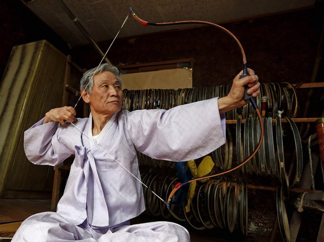 South Korean traditional bow artisan Kwon Yeong-Hak works on a bow in his workshop in Yecheon-gun, Gyeongsangbuk-do, South Korea, 26 February 2015. (Photo by Jeon Heon-Kyun/EPA)