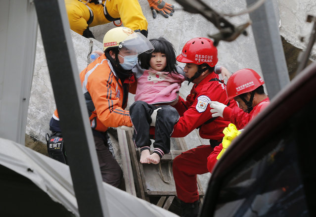 A young girl is rescued from a collapsed building after an earthquake in Tainan, Taiwan, Saturday, February 6, 2016. (Photo by Wally Santana/AP Photo)