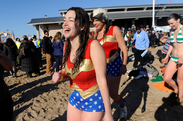 A woman dressed as Wonder Woman laughs after participating in the annual Polar Bear Plunge in Coney Island in the Brooklyn Borough of New York City, U.S. January 1, 2017. (Photo by Stephanie Keith/Reuters)