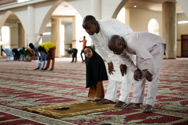 Nigerians bow in the main mosque during Friday prayers, in the capital Abuja, Nigeria, Friday, March 27, 2015. Nigerians are due to go to the polls to vote in presidential elections on Saturday. (Photo by Jerome Delay/AP Photo)
