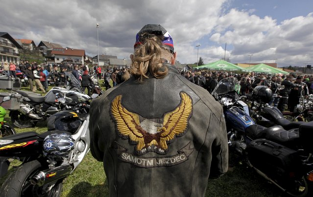 A rider looks at motorcycles during the first gathering of motorists at the beginning of the spring season in Mirna Pec April 6, 2015. (Photo by Srdjan Zivulovic/Reuters)