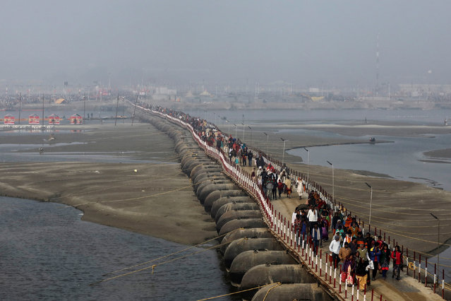 """Devotees leave after taking a holy dip during """"Kumbh Mela"""", or the Pitcher Festival, in Prayagraj, previously known as Allahabad, India, January 14, 2019. (Photo by Anushree Fadnavis/Reuters)"""