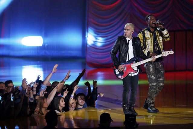 Pete Wentz of Fall Out Boy performs with rapper Fetty Wap during the 2015 MTV Movie Awards in Los Angeles, California April 12, 2015. (Photo by Mario Anzuoni/Reuters)