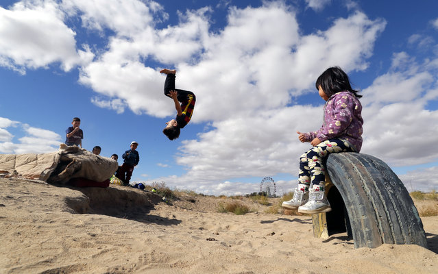 Children play at a park in Baikonur, Kazakhstan, 07 October 2018. Baikonur is the location of the Russian leased Baikonur cosmodrome. (Photo by Yuri Kochetkov/EPA/EFE)