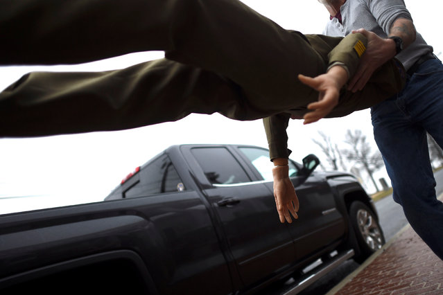 A wax figure of President Dwight D. Eisenhower is carried to a truck after it was purchased from an auction of the Hall of Presidents Museum, which closed in November, in Gettysburg, Pennsylvania, U.S. January 14, 2017. (Photo by Mark Makela/Reuters)