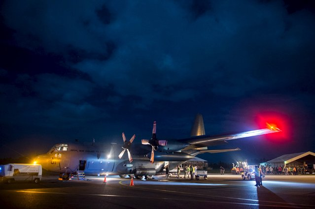 Aid supplies including generators, ration packs and water containers are unloaded from a Royal New Zealand Air Force C-130 Hercules aircraft after Cyclone Winston in Suva, Fiji, in this handout image supplied by the New Zealand Defence Force February 23, 2016. (Photo by Reuters/NZ Defence Force)