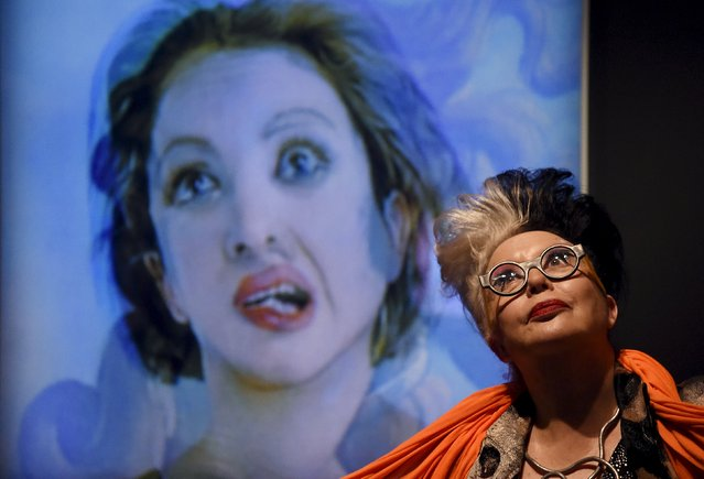 """French artist """"ORLAN"""" poses next to a photographic portrait of herself superimposed with Botticelli's Venus at the Victoria and Albert museum in London, Britain, March 2, 2016. (Photo by Toby Melville/Reuters)"""