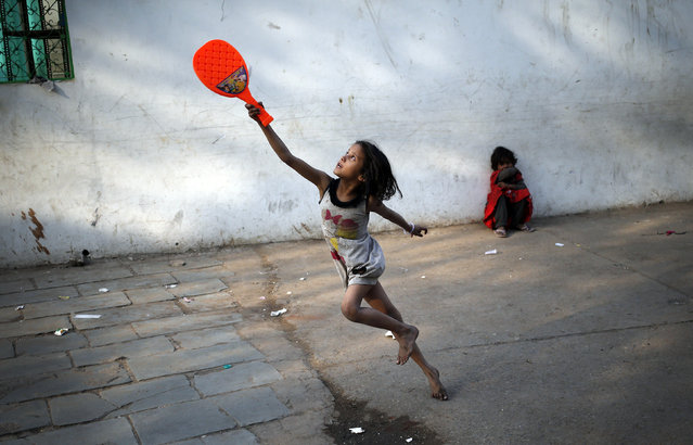 A child plays with a plastic badminton racket in the old quarters of Delhi, India, March 3, 2016. (Photo by Anindito Mukherjee/Reuters)