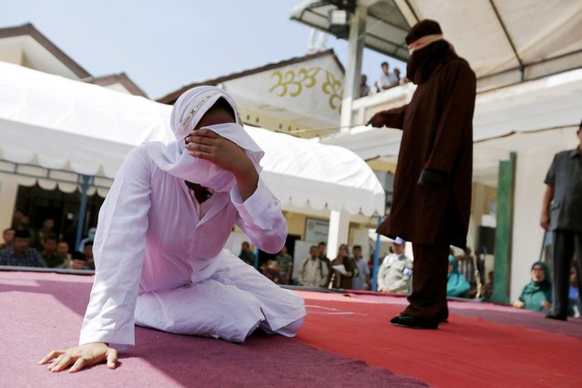 An Acehnese woman collapses after being whipped in front of the public for violating sharia law in Banda Aceh, Indonesia, 02 February 2017. (Photo by Hotli Simanjuntak/EPA)