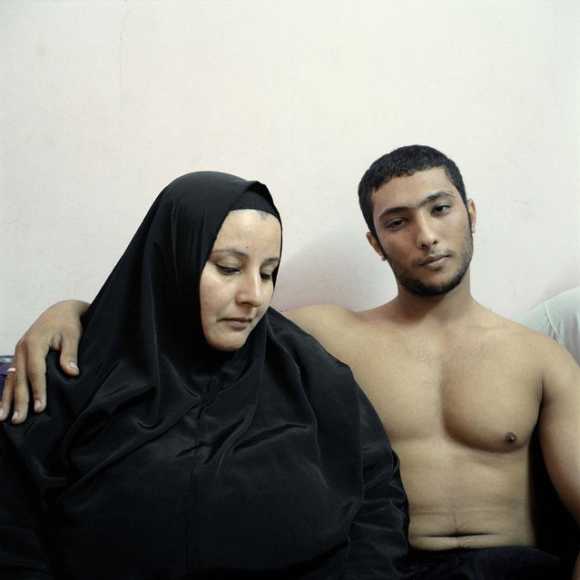2nd prize in the People Staged Portraits Stories category. Denis Dailleux, France, for Agence Vu. The photo shows Ali, a young Egyptian bodybuilder, posing with his mother in Cairo. (Photo by Denis Dailleux/World Press Photo)