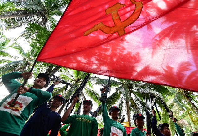 Fighters of the New People's Army-Melito Glor Command (NPA-MGC) conduct a drill during their 50th founding anniversary celebration at an undisclosed location in the mountains of Sierra Madre, Philippines, 31 March 2019 (issued 05 April 2019). According to reports, the fight for communism is still alive in the mountains of the Philippines, with the New People's Army (NPA) celebrating the 50-year anniversary of the movement taking up arms on March 29. The NPA, the armed wing of the Communist Party of the Philippines (CPP), is the oldest fighting communist guerrilla force in Asia. (Photo by Alecs Ongcal/EPA/EFE)