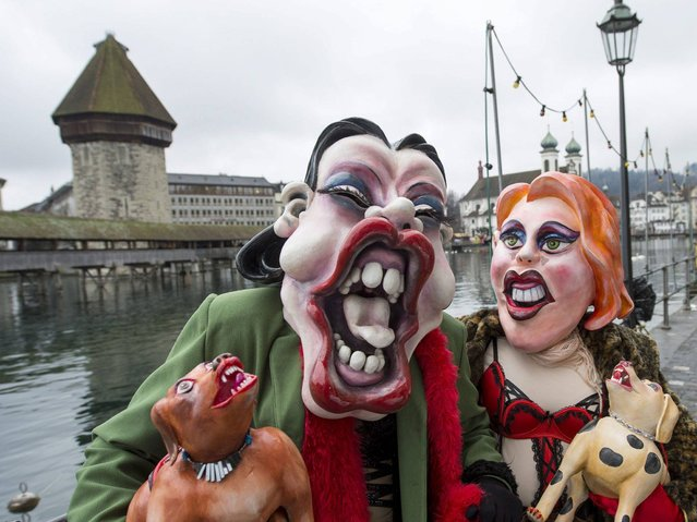 Participants dressed as prostitutes wander the streets of Lucerne. (Photo by Sigi Tischler/Keystone)