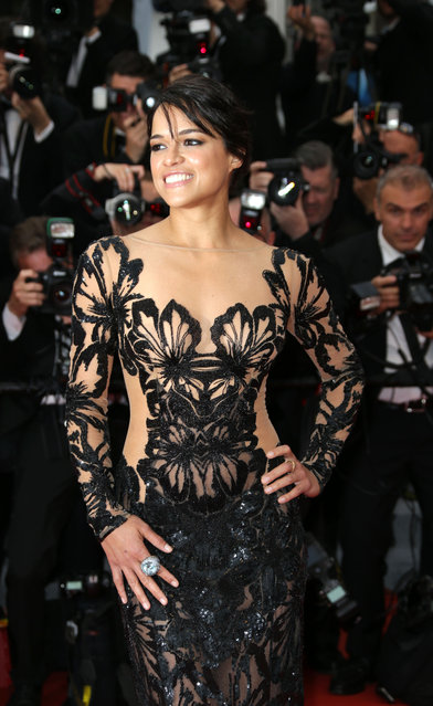 "Actress Michelle Rodriguez poses for photographers on the red carpet for the screening of the film ""Mad Max: Fury Road"" at the 68th international film festival, Cannes, southern France, Thursday, May 14, 2015. (Photo by Lionel Cironneau/AP Photo)"