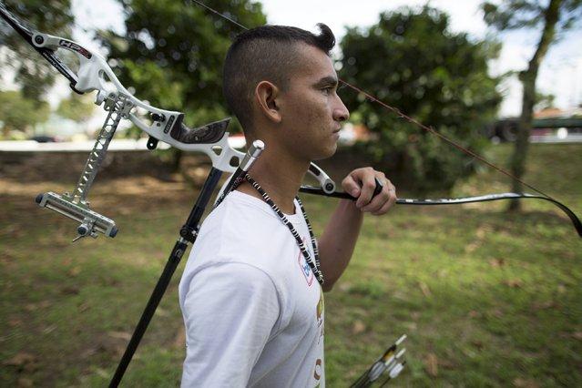 Kambeba Indian, Dream Braga, 18, walks at a training centre in Manaus, Amazon state May 7, 2015. (Photo by Bruno Kelly/Reuters)