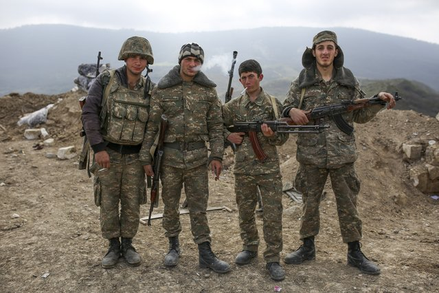 Armenian soldiers pose near a frontline in Nagorno-Karabakh, Azerbaijan, Wednesday, April 6, 2016. A cease-fire largely held Wednesday around Nagorno-Karabakh after an outburst of fighting that raised fears of a new all-out war between Azerbaijani and Armenian forces. (Photo by Karo Sahakyan/PAN Photo via AP Photo)
