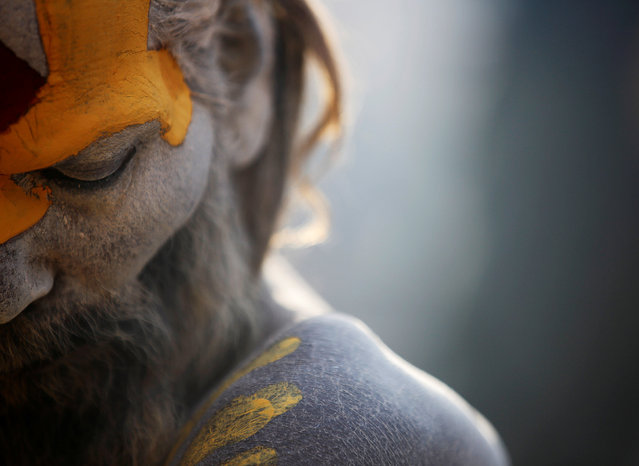 A Hindu holy man, or sadhu, smeared with ashes is pictured as he sits at the premises of Pashupatinath Temple during the Shivaratri festival in Kathmandu, Nepal February 24, 2017. (Photo by Navesh Chitrakar/Reuters)
