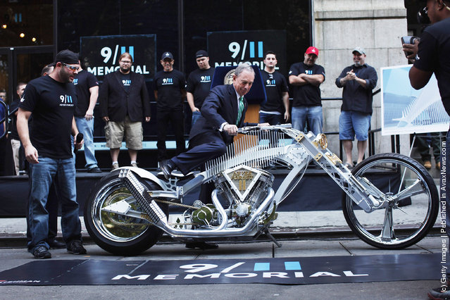 New York City Mayor Michael Bloomberg sits a custom made World Trade Center inspired motorcycle in front of the 9/11 Memorial Preview Site