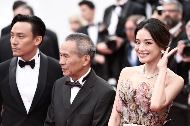 """(L-R) Actor Chang Chen, director Hou Hsiao-Hsien and actress Shu Qi attend the closing ceremony and """"Le Glace Et Le Ciel"""" (Ice And The Sky) Premiere during the 68th annual Cannes Film Festival on May 24, 2015 in Cannes, France. (Photo by Ian Gavan/Getty Images)"""