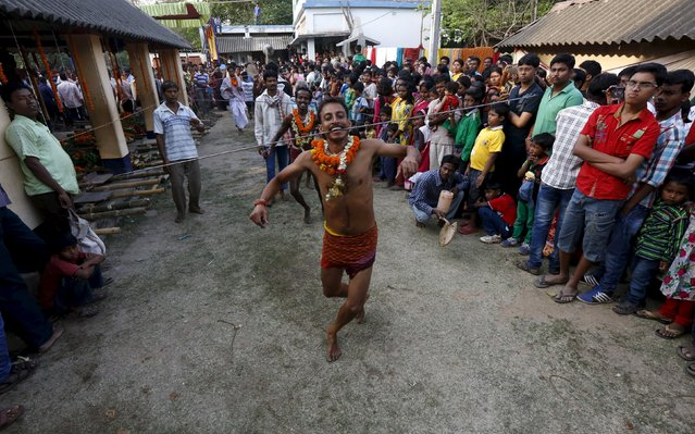 Hindu devotees with their tongues pierced with metal skewers dance during the annual Shiva Gajan religious festival in Banga village in West Bengal, India, April 13, 2016. (Photo by Rupak De Chowdhuri/Reuters)