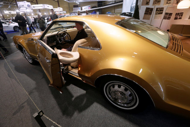 """Oldsmobile Toronado of year 1966 is displayed at the """"Auto Exotica 2016"""" car show in Riga, Latvia, April 15, 2016. (Photo by Ints Kalnins/Reuters)"""