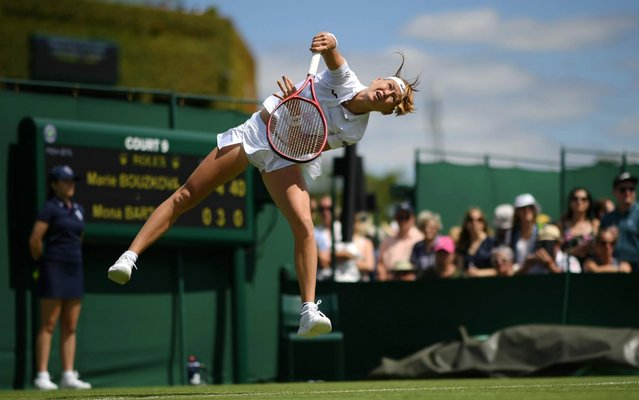 Marie Bouzkova of Czech Republic serves during the Ladies' Singles first round match against Mona Barthel of Germany during Day one of The Championships – Wimbledon 2019 at All England Lawn Tennis and Croquet Club on July 01, 2019 in London, England. (Photo by Matthias Hangst/Getty Images)